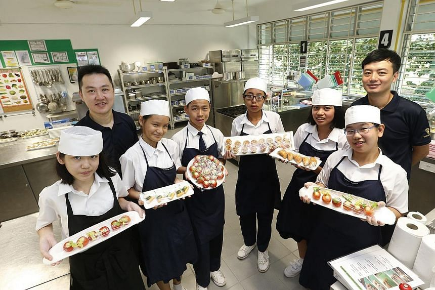 Students showing their food preparation in the F&B training room. Special needs students at Katong School will now have two industrial-grade kitchens to hone their  skills and improve their chances of landing jobs in the Food and Bevera