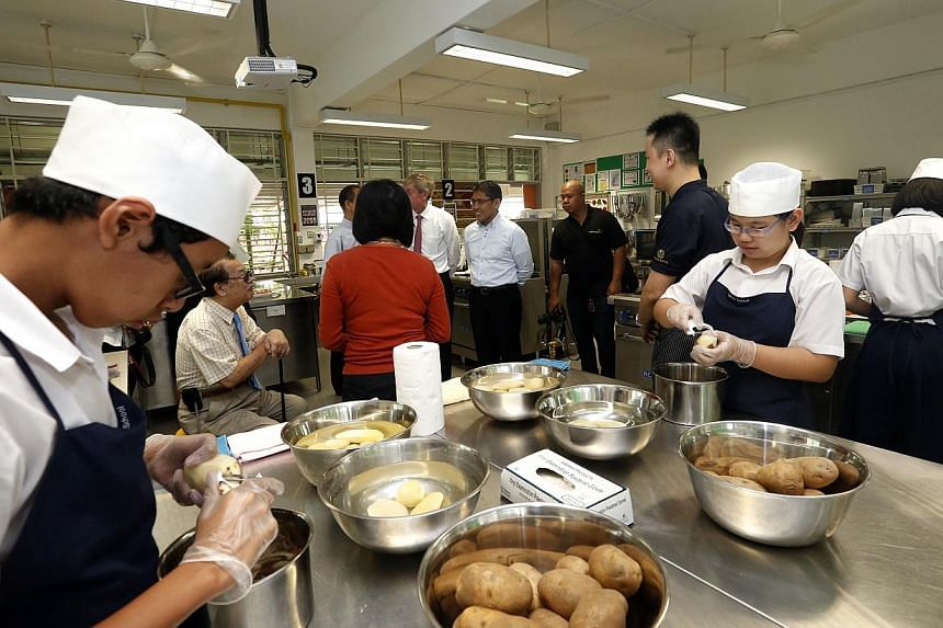 Secondary Students preparing the sweet and savoury appetisers in the APSN Katong F&B training room.  -- ST PHOTO: CHEW SENG KIM