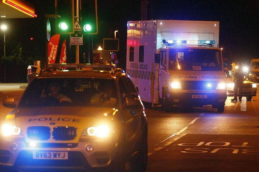 Police escort a Royal Armed Forces (RAF) ambulance carrying a British man infected with the Ebola virus after he was flown home on a C-17 plane from Sierra Leone, at Northolt air base outside London, on Aug 24, 2014. British nurse William Pooley, who