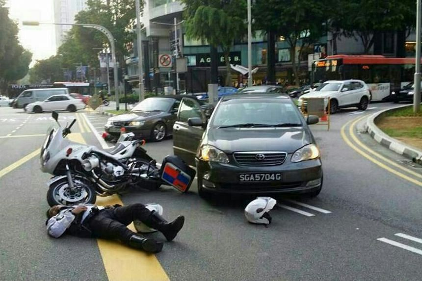 A traffic police officer was involved in a collision with a car yesterday at the junction of Scotts Road and Orchard Road.-- PHOTO: STOMP