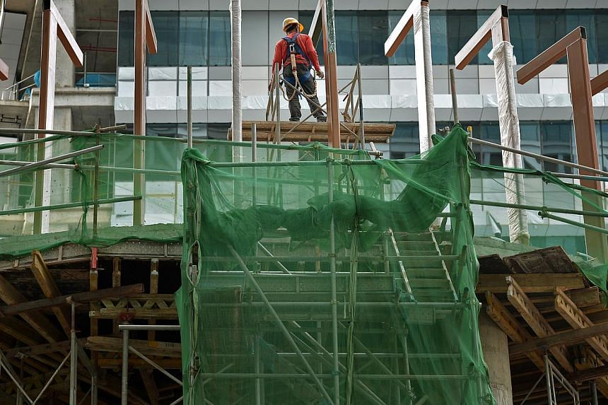 Construction demand is expected to be sustained at between $25 billion to $34 billion a year for 2015 and 2016. -- PHOTO: ST FILE