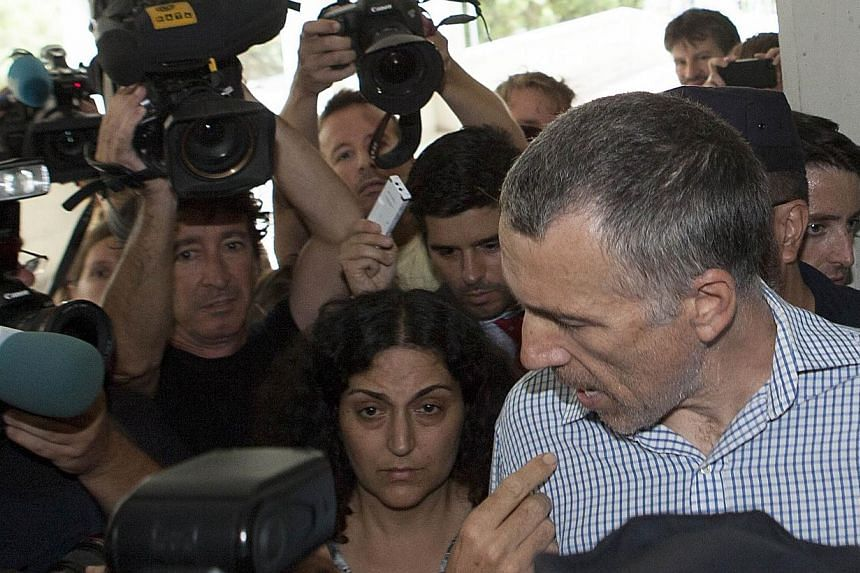 British parents Brett and Naghemeh King (centre) arrive at the maternity ward at the Regional University Hospital in Malaga on Sept 3, 2014, where their five-year-old son, Ashya King, was placed after Spanish police arrested his parents. The fat