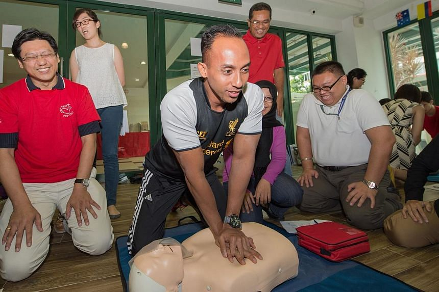 """School staff learning how to become lifesavers as part of the Singapore Heart Foundation's """"Start A Heart"""" project on 30 June 2014. More cardiac arrest patients are receiving cardiopulmonary resuscitation, or CPR, from bystanders, leading to a"""