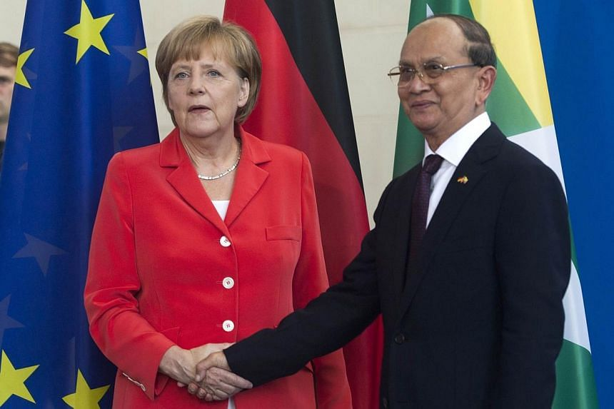 German Chancellor Angela Merkel greets the President of Myanmar Thein Sein on his arrival for a meeting at the Chancellery in Berlin on Wednesday, Sept 3, 2014.Dr Merkel on Wednesday pledged further economic support for Myanmar if it holds fair