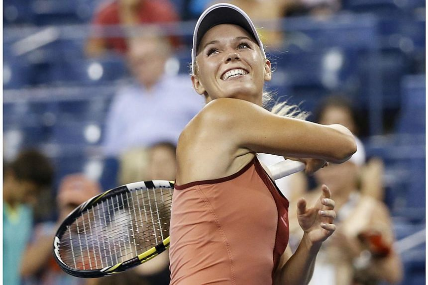 Caroline Wozniacki of Denmark celebrates defeating Sara Errani of Italy in their women's quarter-finals singles match at the 2014 U.S. Open tennis tournament in New York, on Sep 2, 2014. Caroline Wozniacki used her aggressive groundstroke game t