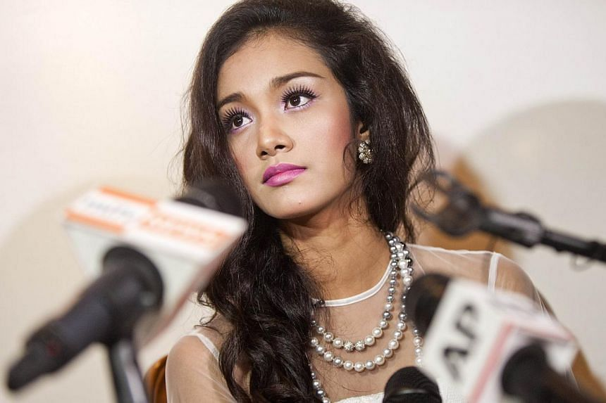 Dethroned beauty queen May Myat Noe gives a news conference in Yangon on Sept 2, 2014. -- PHOTO: AFP