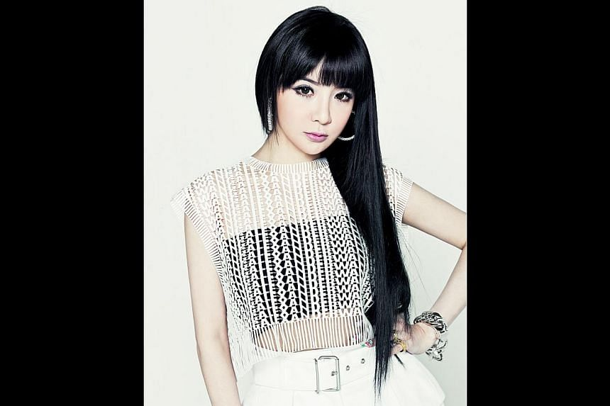 2NE1 members Park Bom (above), Minzy, Dara and CL appear more relaxed in their home city of Seoul than when they are overseas for promotions or performances. -- PHOTO: YG ENTERTAINMENT AND LIVE NATION KOREA