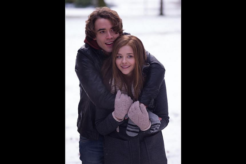 Chloe Grace Moretz (above, with Jamie Blackley, in If I Stay), who says this foray into soft-focused romance does not mean she has abandoned her innate preference for stronger roles such as Hit-Girl in Kick-Ass. -- PHOTO: WARNER BROS