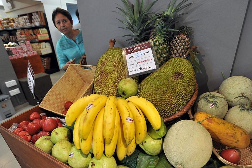 A fruit display at an Agrobazaar Malaysia stall. Located at Sultan Gate off Beach Road, the bazaar stocks authentic Malaysian produce, including fruit and groceries. -- PHOTO: LIM YAOHUI FOR THE STRAITS TIMES