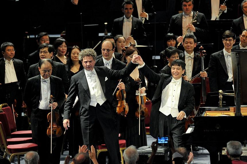 The SSO performed at the BBC Proms, conducted by Shui Lan (right, in front) with Andreas Haefliger(left, in front) on piano. -- PHOTO: BBC/CHRIS CHRISTODOULOU