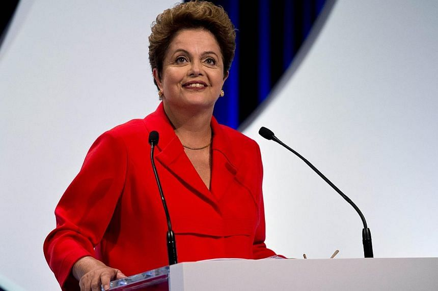 Presidential candidate for the Brazilian Workers' Party and current Brazilian President Dilma Rousseff attends the second television debate in Sao Paulo, Brazil on Sept 1, 2014. -- PHOTO: AFP