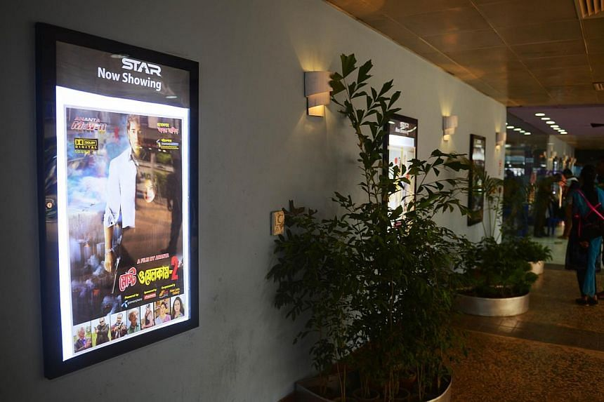 """A film poster advertising Bangladeshi film """"Most Welcome 2"""" hanging in front of a cinema hall at a shopping mall in Dhaka on September 3, 2014. The authorities in Bangladesh have banned local film-makers from giving their movies English titles after"""