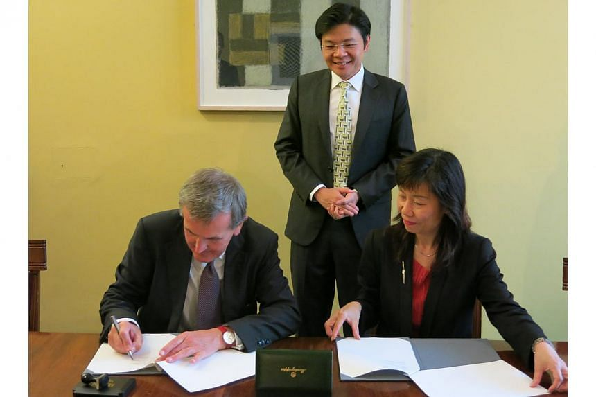 Mr Lawrence Wong, Minister for Culture, Community and Youth (centre), witnessing the signing of the inaugural memorandum of understanding between the National Heritage Board and the British Museum. The memorandum was signed by Mr Neil MacGregor, dire