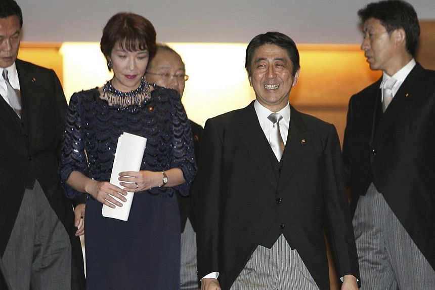 From left, Japanese Foreign Minister Taro Aso, Gender Equality Minister Sanae Takaichi, Justice Minister Jinen Nagase, Prime Minister Shinzo Abe, and Chief Cabinet Secretary Yasuhisa Shiozaki. Abe named five women to his new cabinet on Sept 3, which