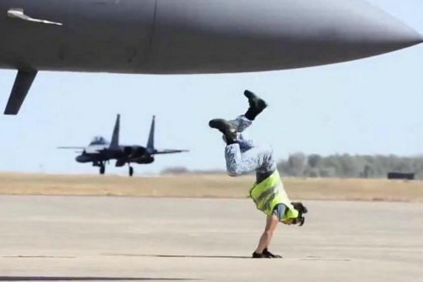 A video featuring a Republic of Singapore Air Force (RSAF) marshaller pulling off a series of slick breakdancing moves including a windmill, cartwheel and backflip - all as he points an airplane into flight - has gone viral. -- PHOTO: REPUBLIC OF SIN