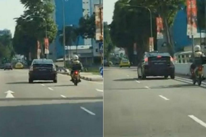Screengrabs from a video, posted by Facebook user Alan Kong, showing a Toyota Prius taxi swerving twice into the lane of an oncoming motorcycle in a reckless manner. -- PHOTO: ALAN KONG/FACEBOOK