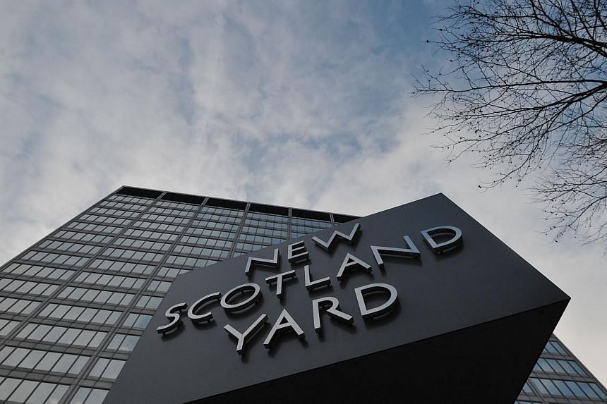 A picture dated January 11, 2013 shows the rotating sign outside New Scotland Yard, the headquarters of the Metropolitan Police, in central London. London's world-famous Scotland Yard, a 22-storey, 56,000-square-metre office block, has been put up fo