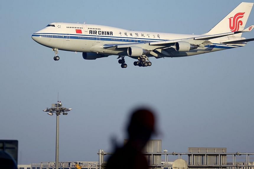 This picture taken on Sept 3, 2014 shows an Air China Boeing 747 preparing to land at Beijing Capital International airport.China will need more than 6,000 new aircraft over the next 20 years, US manufacturer Boeing forecast Thursday - an incre
