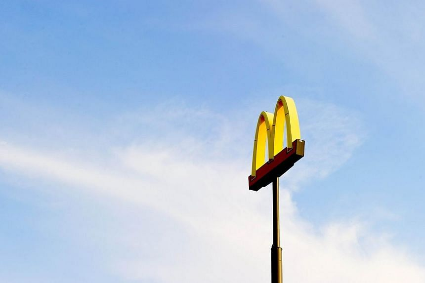 A sign for McDonalds in Bismarck, North Dakota on Aug 18, 2013. Fast-food workers will stage another day of protests in more than 150 US cities on Thursday as they seek a doubling in hourly pay to US$15 (S$18.75) and the right to form a union. -- PHO