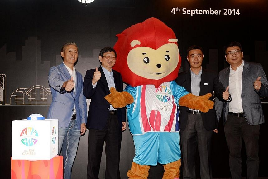 (From left) Mr Anthony Chong, Mr Patrick Lee, Mr Toh Boon Yi and Mr Danny Lam with the SEA games 2015 mascot at the announcement of localcommunication design and production group Kingsmen Creatives as the SEA Games'official venue planning