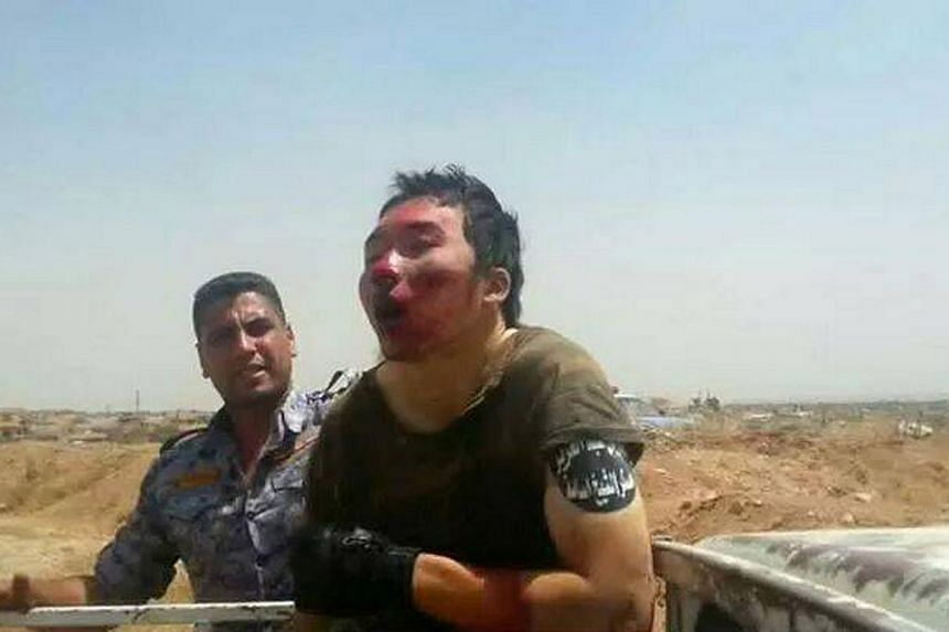 Iraqi Ministry of Defence/Iraq says it has captured an Islamic State militant from China, which would, if proven, make the man the first confirmed Chinese national to be found fighting for the extremist Sunni militant group. -- PHOTO: IRAQI