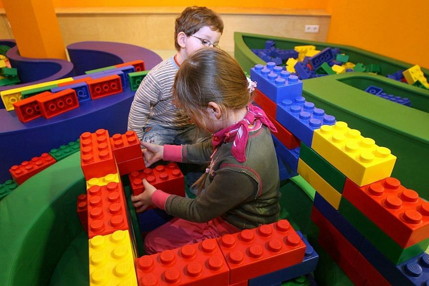 A young girl building a structure with giant rubber Lego bricks at Berlin's Legoland Discovery Centre on March 29, 2010. Danish toy maker Lego has taken the top spot as the world's biggest maker of toys by sales, overtaking Barbie doll-maker Mat