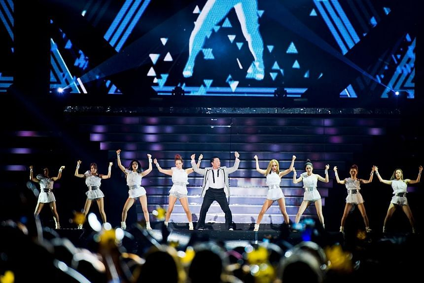 K-pop star Psy performing at Jamsil Olympic Stadium in Seoul, South Korea on Aug 15, 2014.-- PHOTO:YG ENTERTAINMENT AND LIVE NATION KOREA
