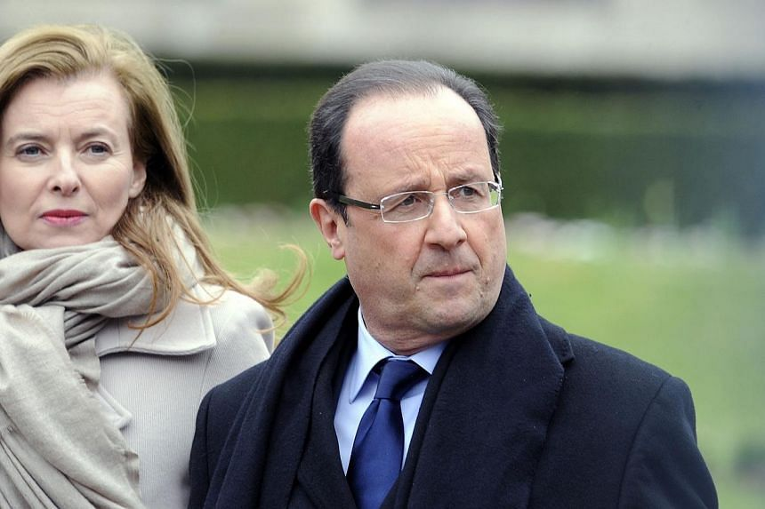 French President Francois Hollande (right) and then his partner Valerie Trierweiler leaving the Prefecture of Correze in Tulle where Hollande was a local representative on April 6, 2013. -- PHOTO: AFP