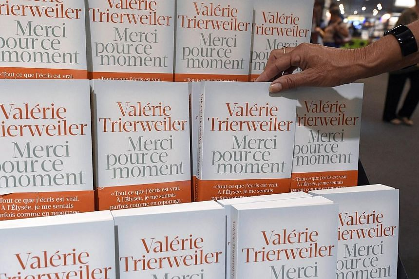 """A person takes in a Montpellier bookstore on Sept 4, 2014, a copy of the book of French President's former partner Valerie Trierweiler entitled """"Merci pour ce moment"""" (Thank you for this moment) some hours after its release. -- PHOTO: AFP"""