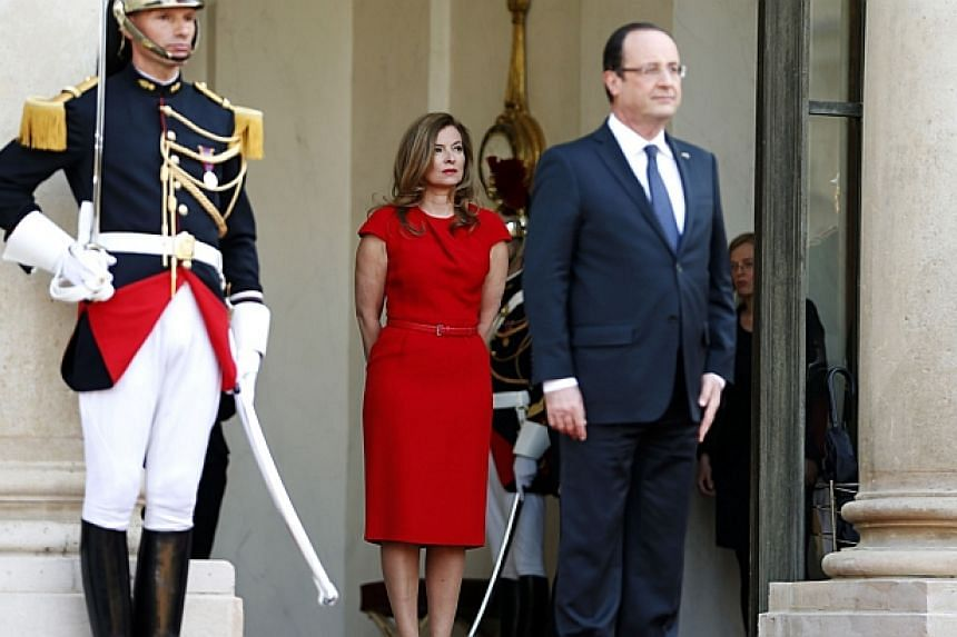 Valerie Trierweiler (centre), former companion of French President Francois Hollande (right), stands behind him before a state dinner at the Elysee Palace in Paris on May 7, 2013. -- PHOTO: REUTERS