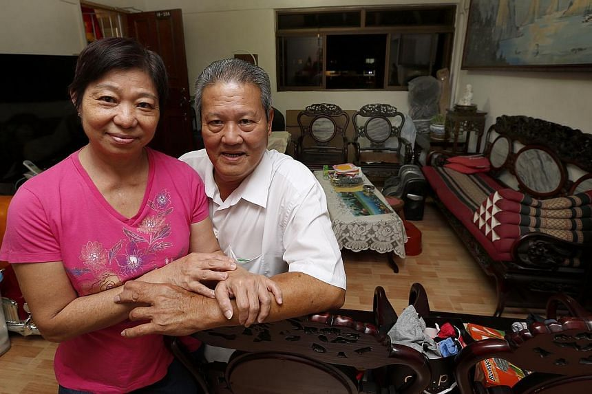 Taxi driver Tan Ah Tee, 65, and his wife Ong Soh Har, 62, prefer to keep their flat so they can leave it to their children.