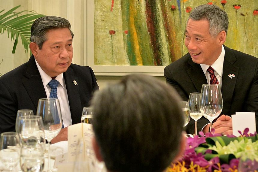 Indonesian President Susilo Bambang Yudhoyono at a lunch at the Istana yesterday hosted by Prime Minister Lee Hsien Loong. Indonesia's Foreign Ministry says the treaty is a reminder for other countries in the region that border disputes can be manage