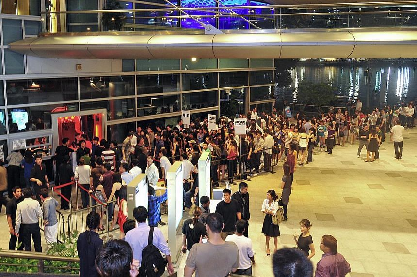 The snaking queue of young trendy clubbers who are willing to wait up to an hour to enter The Butter Factory on weekends. -- PHOTO: ST FILE