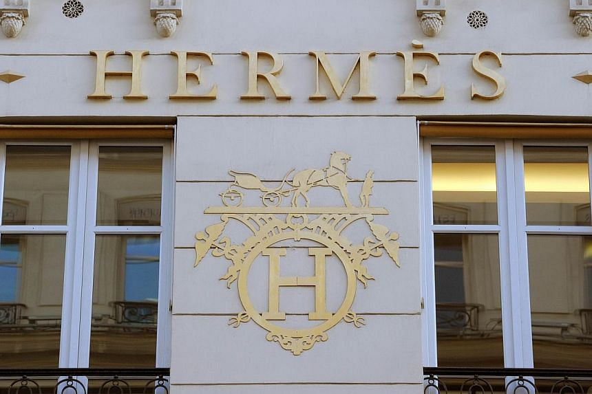A long and bitter battle that has gripped the luxury goods industry and pitted two of France's richest families against each other came to an unexpected end on Wednesday when LVMH and Hermes agreed to a truce. -- PHOTO: AFP
