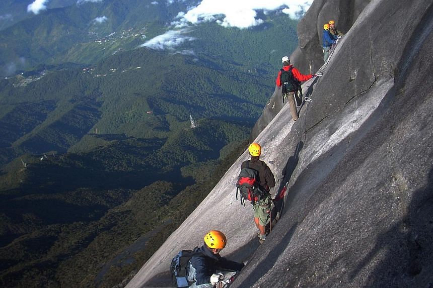 """Via Ferrata or """"Iron Road"""" in Italian is a leisure mountaineering sport with World War I origins. Rungs and cables were constructed on slopes to move soldiers and equipment across the Italian Dolomites to Austria. -- PHOTO: MOUNTAIN TORQ"""