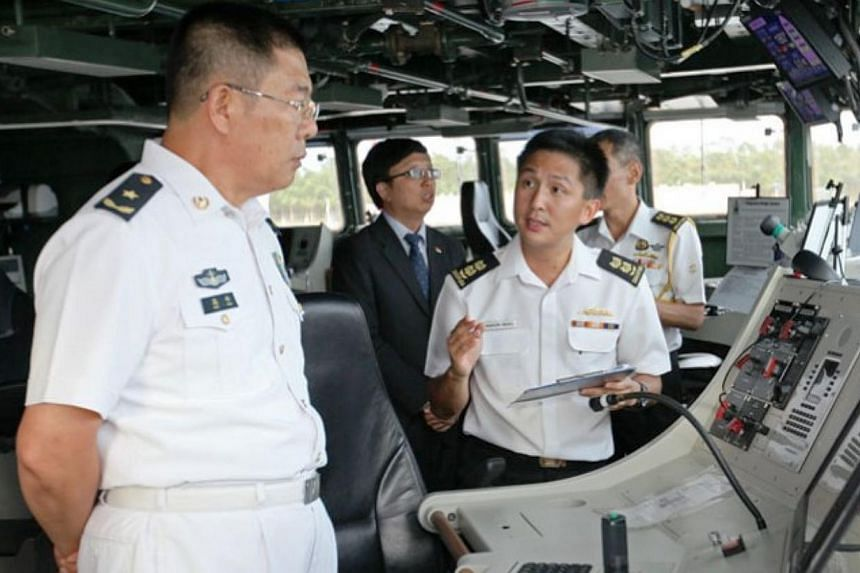 Commanding Officer RSS Intrepid Senior Lieutenant Colonel Aaron Beng (right) briefing Deputy Commander People's Liberation Army (Navy) (PLA(N)) South Sea Fleet (SSF) Rear-Admiral Gao Feng. A bilateral exercise involving warships from the Singapore