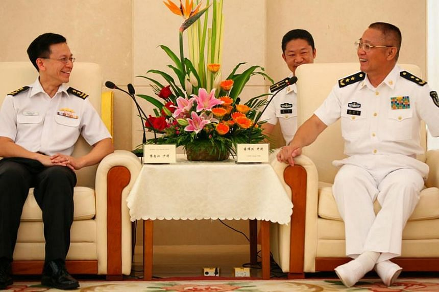 Chief of Navy Rear-Admiral Lai Chung Han (left) calling on Commander PLA(N) SSF Vice-Admiral Jiang Weilie. -- PHOTO: MINDEF