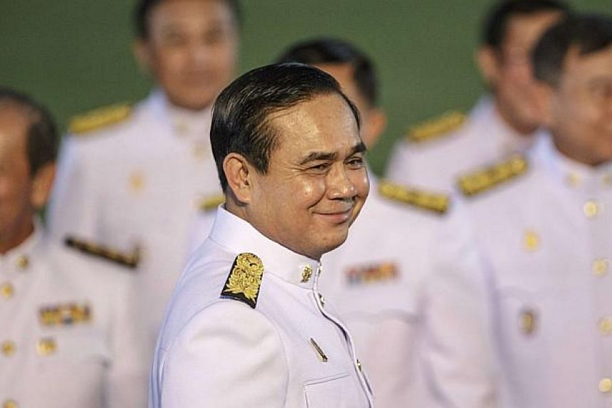 Thailand's Prime Minister Prayuth Chan-ocha smiles after a photo session at Government House following an audience with King Bhumibol Adulyadej at Siriraj Hospital in Bangkok. -- PHOTO: REUTERS