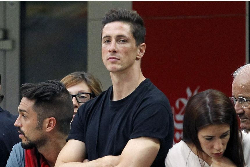 AC Milan's newly signed player Fernando Torres watches their Italian Serie A football match against Lazio at the San Siro stadium in Milan on Aug 31, 2014. -- PHOTO: REUTERS