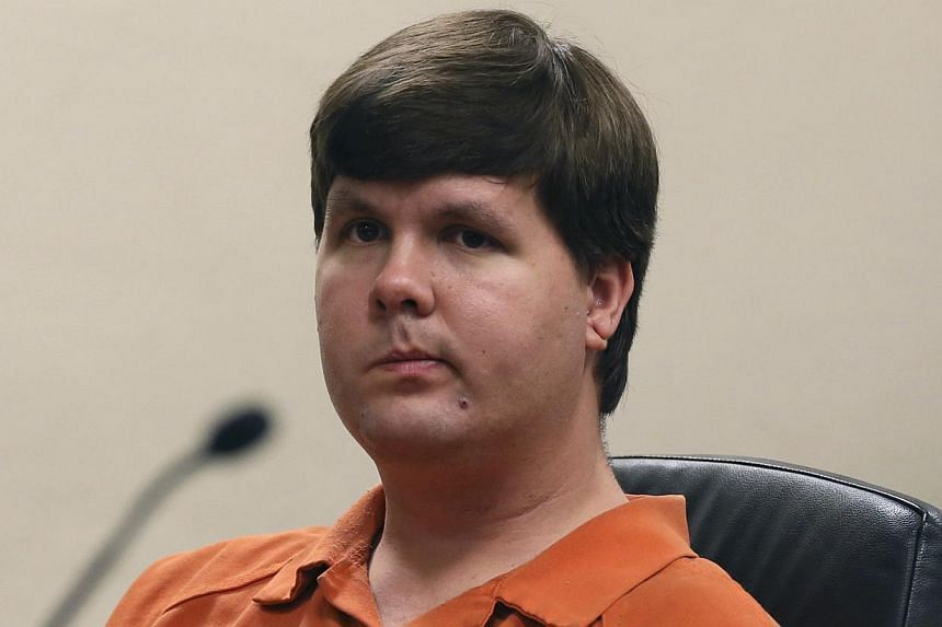 Justin Ross Harris sits in Cobb County Magistrate Court in Marietta, Georgia on July 3, 2014. Harris is being charged with malice murder in the case of his 22-month-old son who he left for seven hours in a car while he was at work June 18, 2014 accor