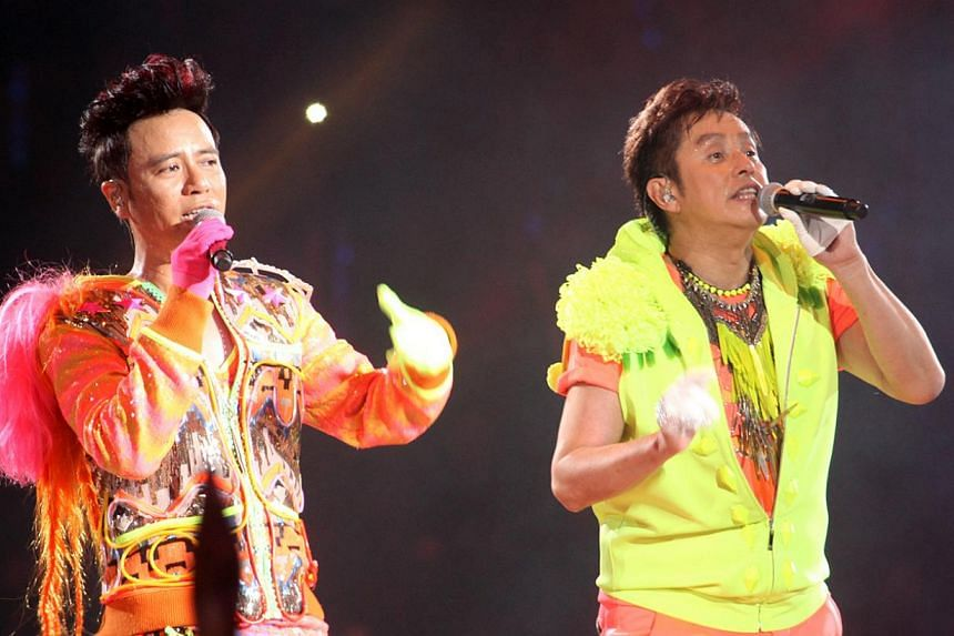 Veteran Hong Kong singers Alan Tam (right) and Hacken Lee will be bringing their 10th anniversary tour to Singapore. -- PHOTO:UNUSUAL ENTERTAINMENT