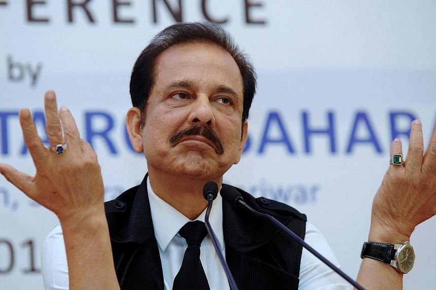 Jailed Indian tycoon Subrata Roy on Friday asked the Supreme Court for more time to negotiate the sale of three luxury foreign hotels to raise the 100 billion rupees (S$2 billion) he needs to secure bail. -- PHOTO: AFP