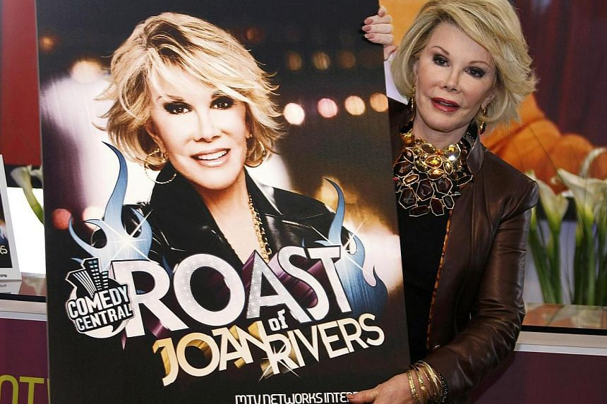 Joan Rivers poses for photographers as she presents Comedy Roast With Joan Rivers at the annual MIPCOM television programme market in Cannes, southeastern France in 2009. -- PHOTO: REUTERS