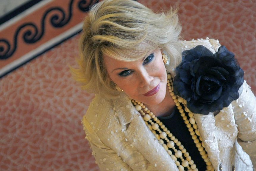 Joan Rivers during a photocall during the 25th edition of the MIPCOM, in Cannes, southern France on Oct 5, 2009. -- PHOTO: AFP
