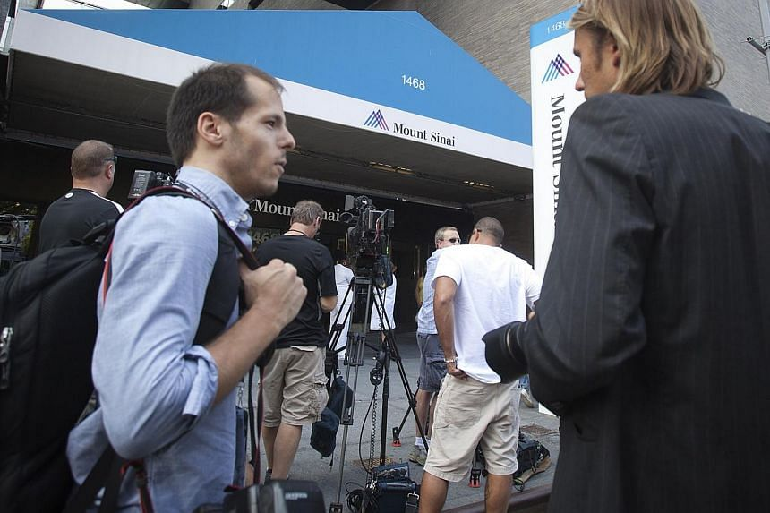 The media stand in front of Mount Sinai hospital on the news that actress Joan Rivers had died, in New York on Sept 4, 2014. Rivers, who became a comedic star with an act that was a mélange of insult, insecurity, over-the-top cattiness and a nothing