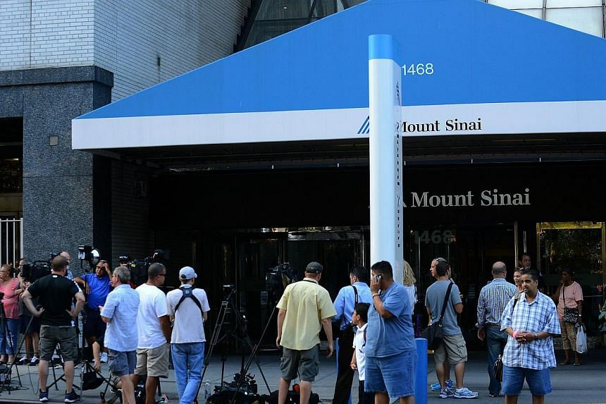 A general view of press outside of Mount Sinai Hospital in New York City on Sept 4, 2014. Joan Rivers passed away on Sept 4, 2014 after suffering respiratory and cardiac arrest during vocal cord surgery on Aug 28, 2014. -- PHOTO: AFP