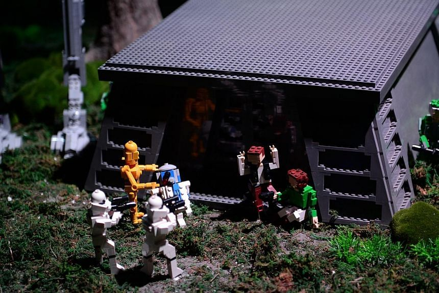 Members of the rebel strike team facing Imperial troopers outside a bunker in the Battle of Endor at the Lego Star Wars Miniland in Legoland, Malaysia on Sept 3, 2014. -- ST PHOTO: JOYCE FANG