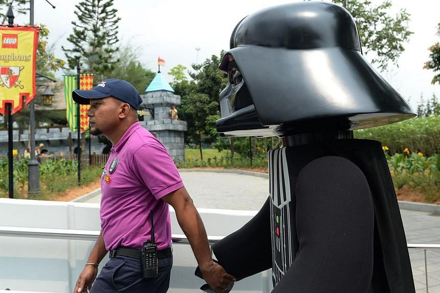 A Darth Vader 'minifig' is led by the hand before the launch of the Lego Star Wars Miniland on Sept 3, 2014. The new miniland will open to the public on September 6 at Legoland, Malaysia.-- ST PHOTO: JOYCE FANG