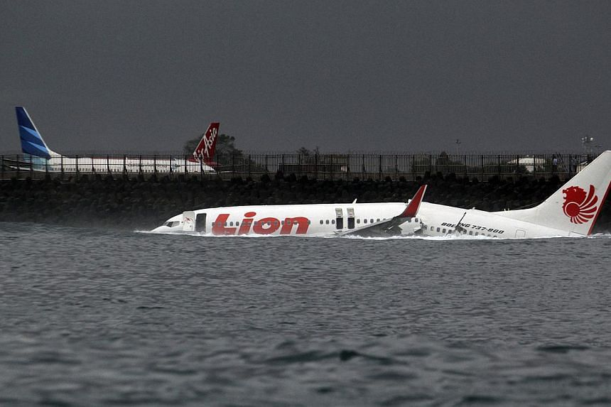 The body of a Lion Air plane is seen in the water after it missed the runway in Denpasar, Bali, in this file picture taken on April 13, 2013. Pilot errors, inadequate crew training and lapses in emergency response procedures led to the plane operated