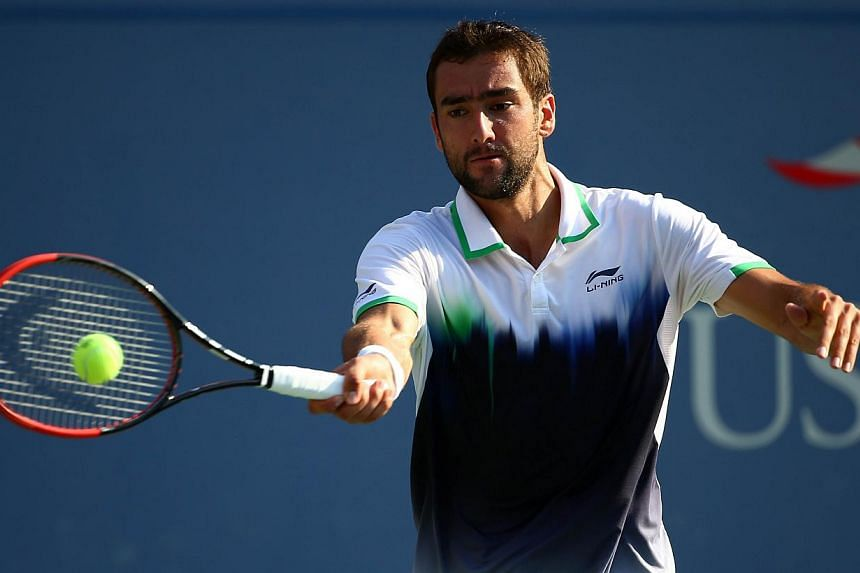 Marin Cilic of Croatia returns a shot to Tomas Berdych of the Czech Republic during their men's singles quarterfinal match on Day Eleven of the 2014 US Open at the USTA Billie Jean King National Tennis Center in the Flushing neighborhood of the Queen